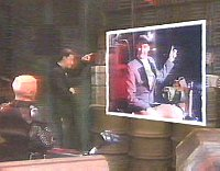 Lister shows Kryten his photo's