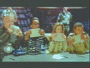 The team lick their envelopes.
