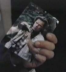 Tom's Photo in Dee's purse.