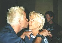 Blonde bloke kisses Patricia Zentelli